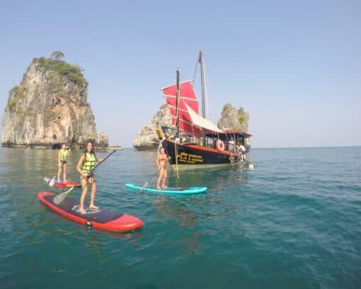 People paddle boarding in waters around Krabi