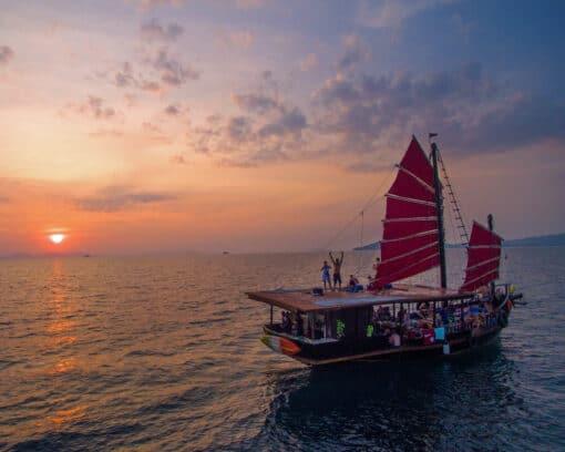 Junk boat on sea around sunset.