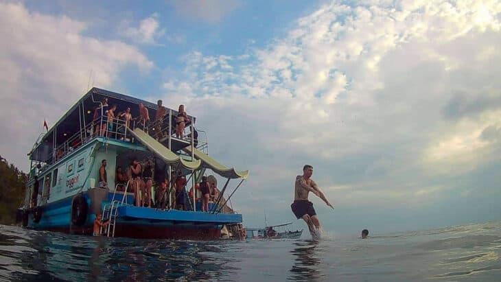 Man jumps from boat near Koh Tao.