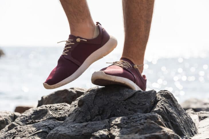 Person climbs on rock in shoes