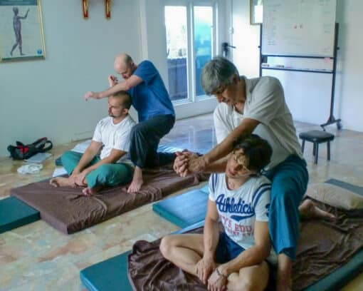 Students learning Thai massage