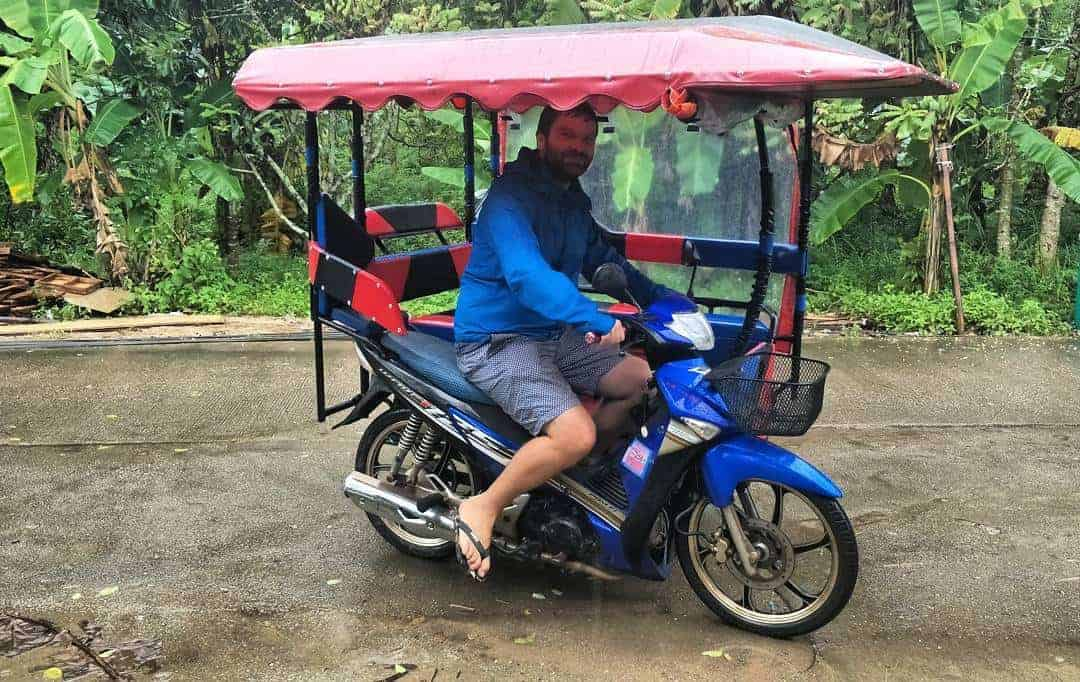 Dave driving a tuk-tuk side car in Thailand!