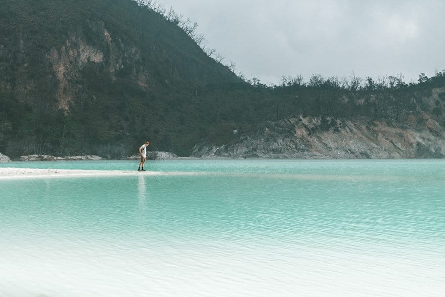 The turquoise water of Kawah Putih crater lake