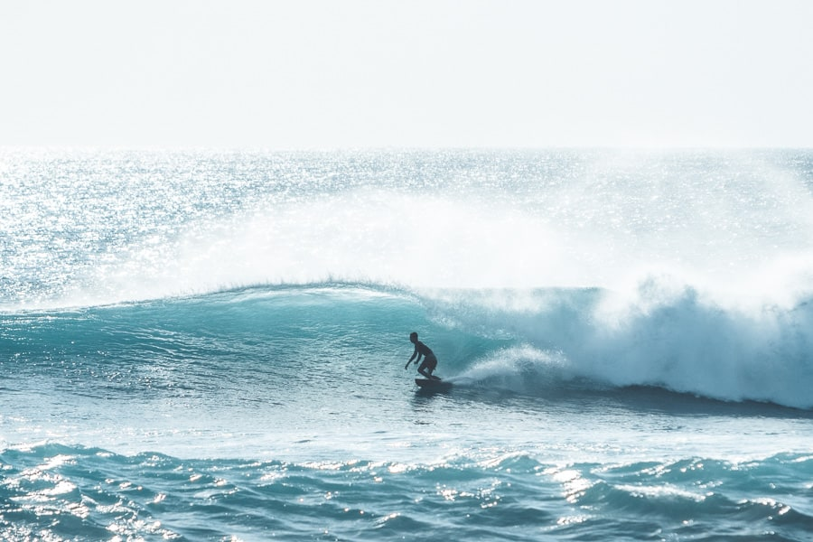 Surfer riding the waves in Bali.