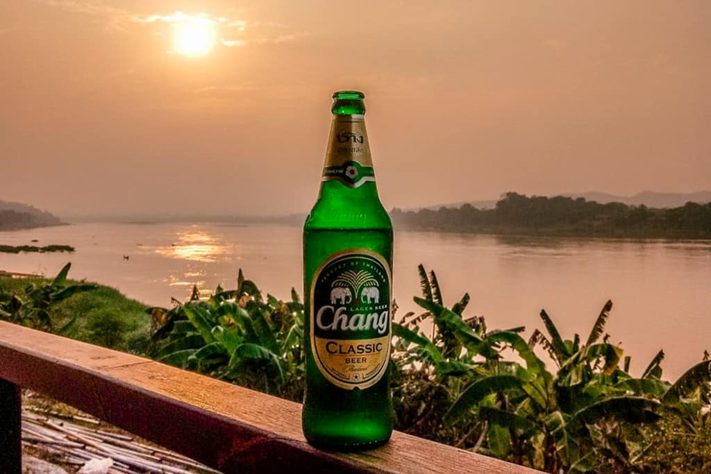Chang beer next to Mekong River