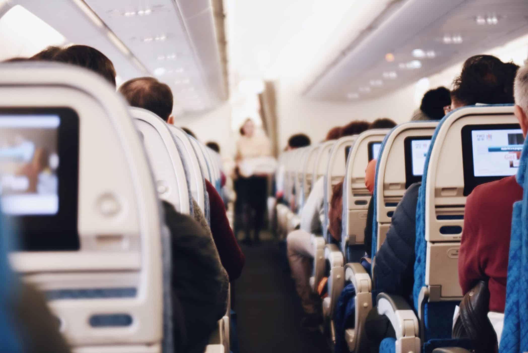 People sitting on an aeroplane.