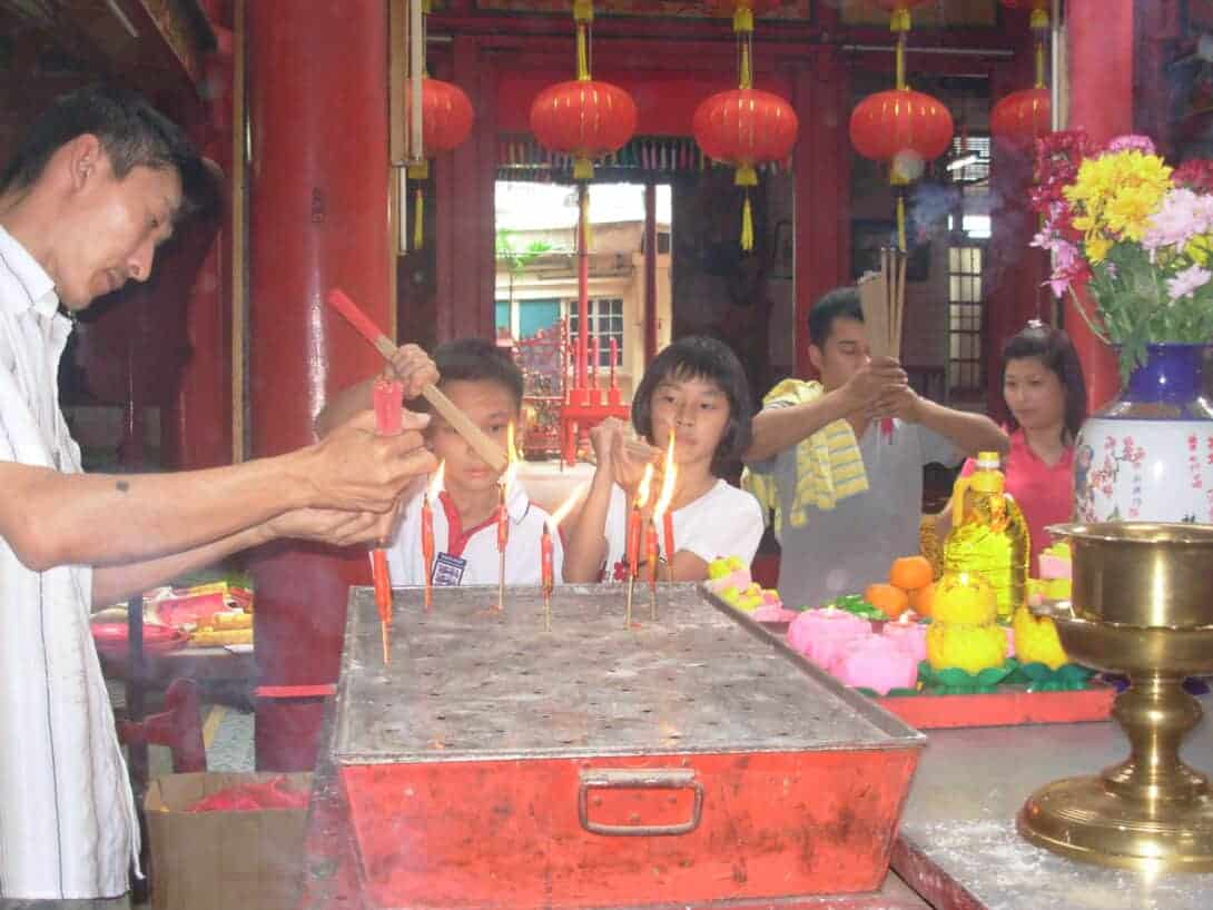 A family at a Chinese Temple during Chinese New Year.