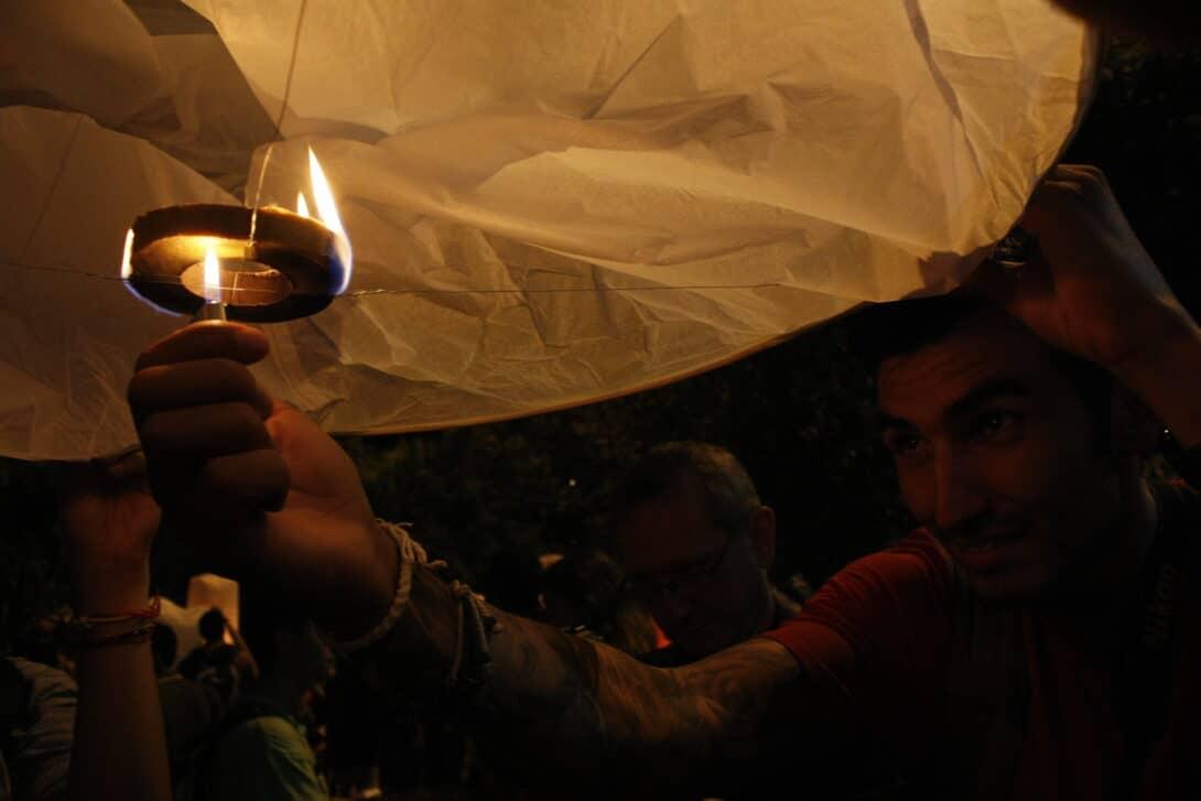 Setting a lantern alight at the Mae Jo Lantern Release.