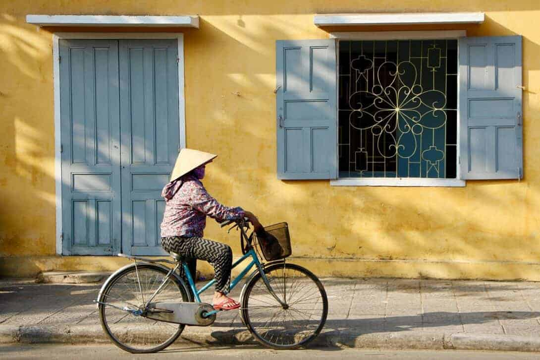 Vietnam, lady on bike