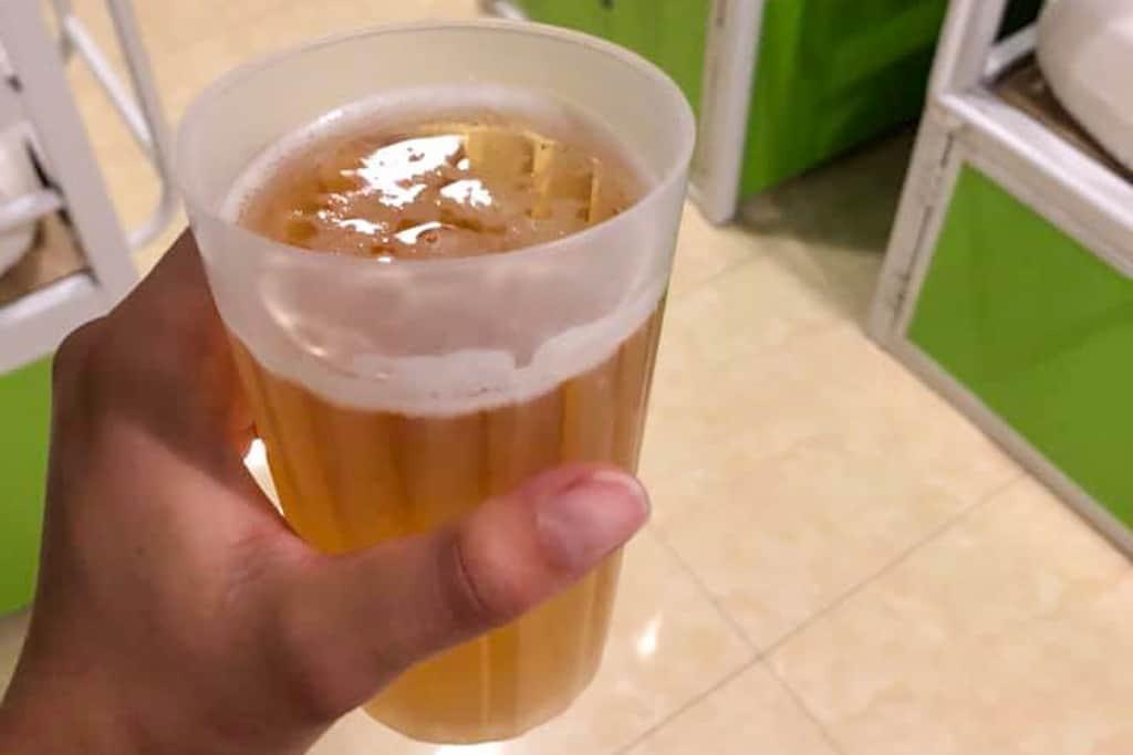 Bia Hoi in plastic glass