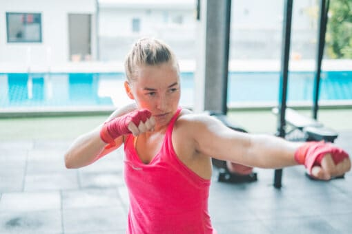 A girl works out at the KohFit Gym.