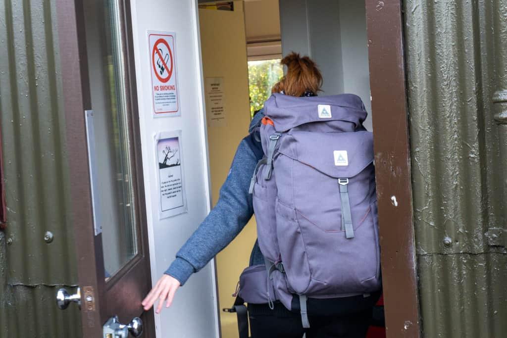 Entering hostel wearing Salkan's The Backpacker