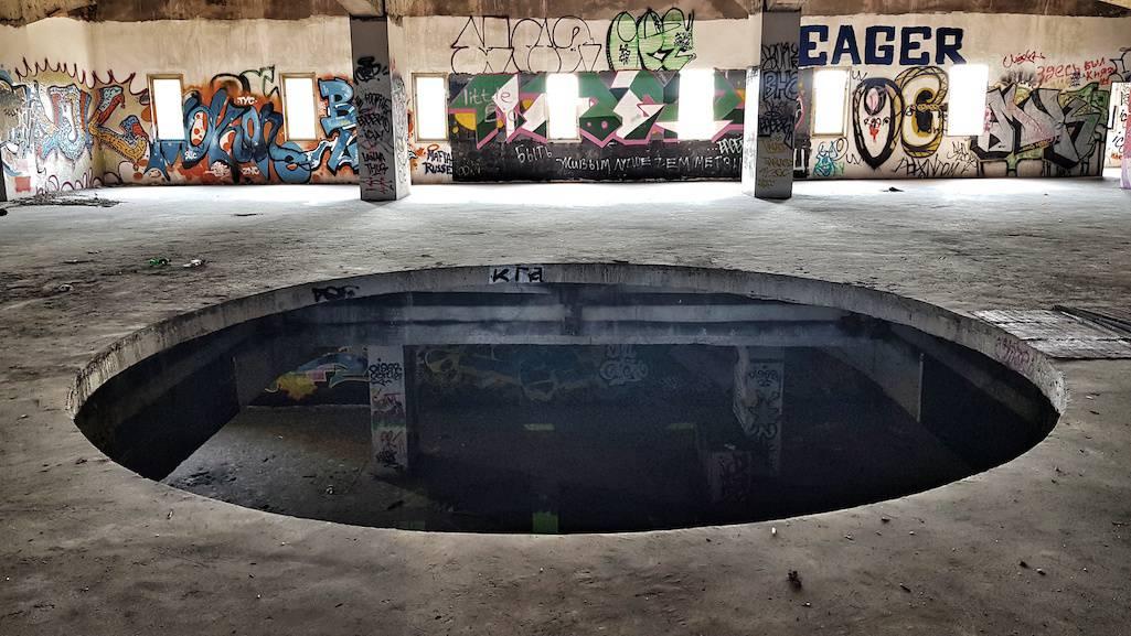 The huge floor hole in the abandoned Batman nightclub, Pattaya.