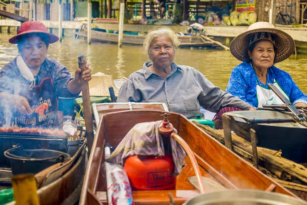 Ladies selling goods at floating market