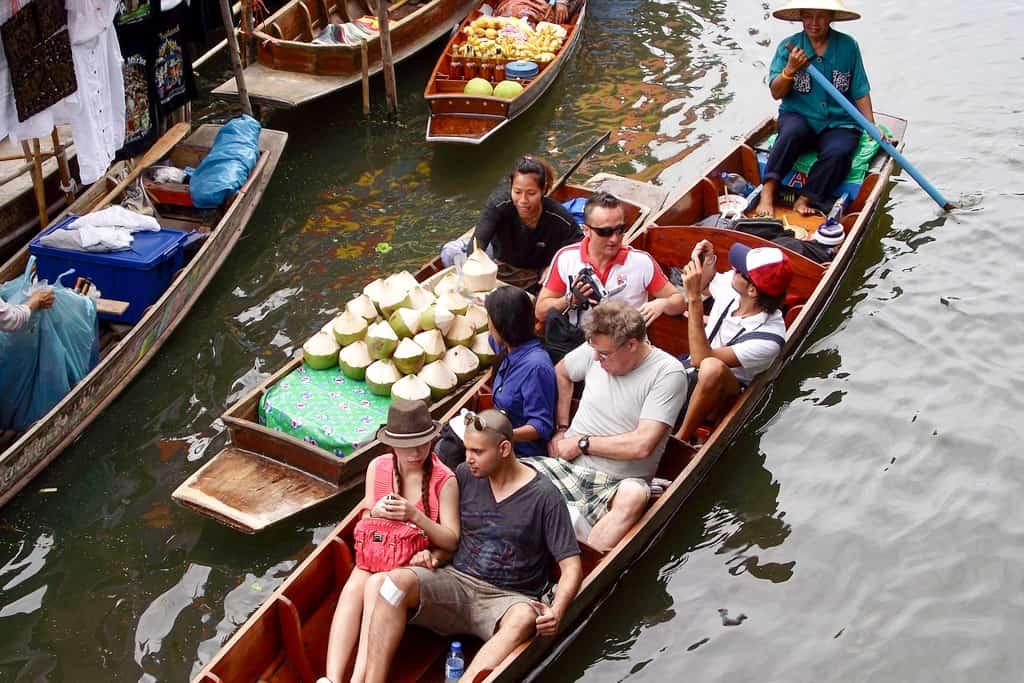 Tourists exploring Thai floating market