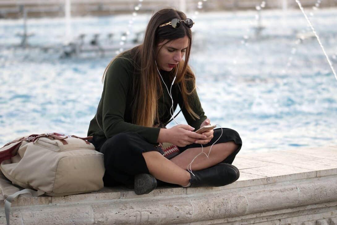 Girl sitting on phone
