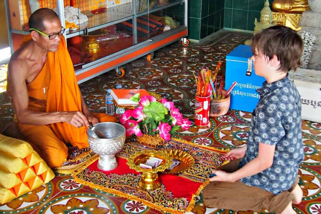 Boy with monk in Cambodia